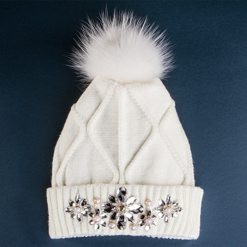 White winter hat with fur and crystals