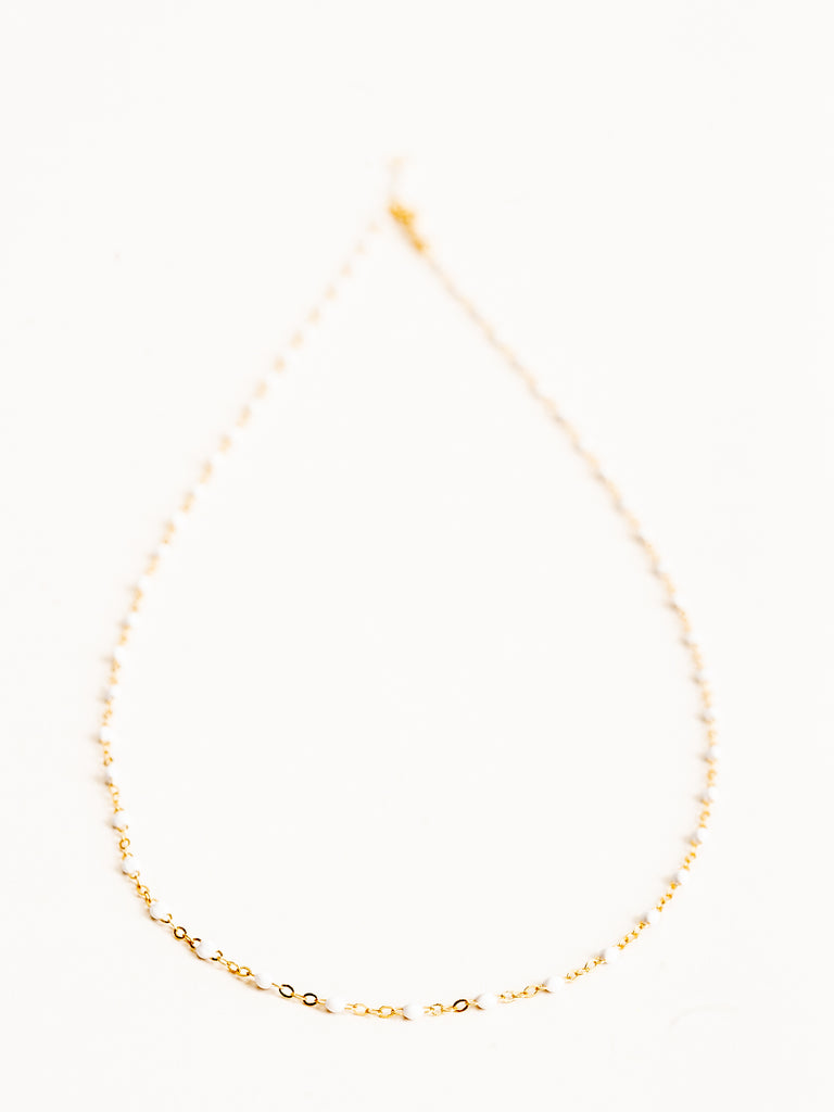 white bead necklace - yellow gold
