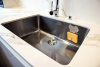 LIB Editeur d'idées Barry the Elephant Aluminum Sponge Holder, shown inside  a kitchen sink