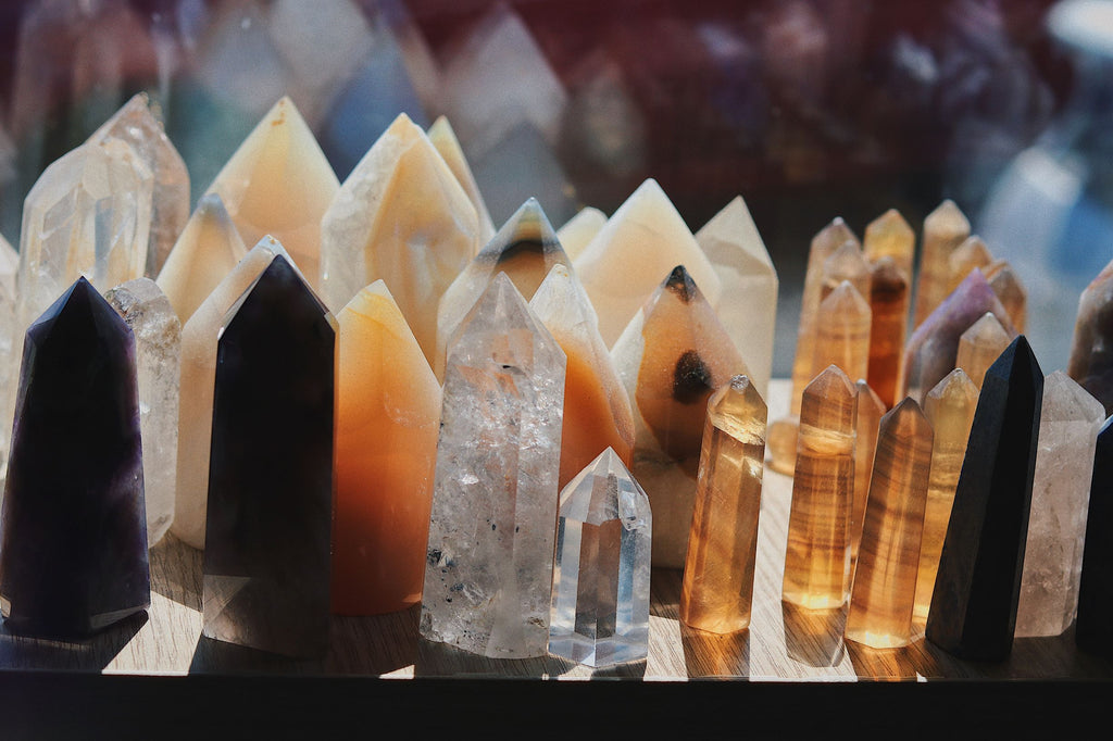 A collected of pointed crystals charging in the sunlight of a windowsill.
