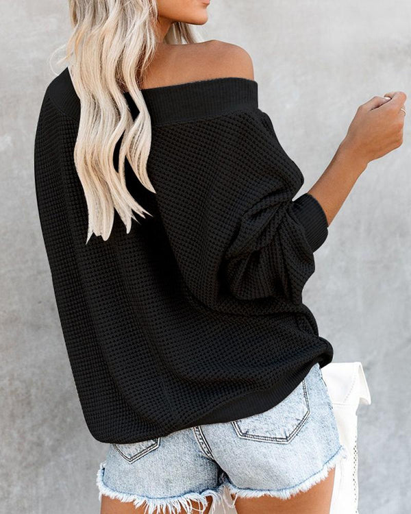 Large V-neck off-the-shoulder sweater