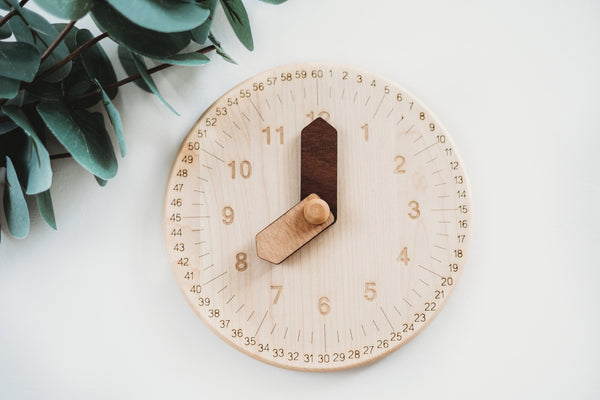 Wooden toy clock with minute and hour in different shades for easy learning