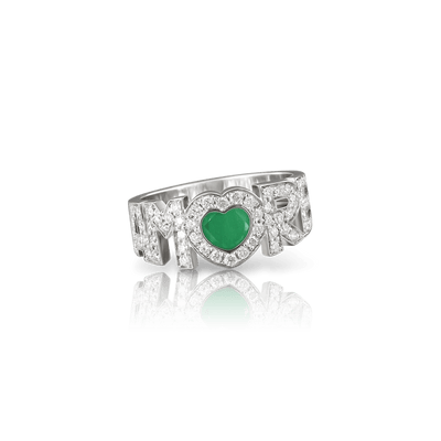 White gold ring with white diamonds and emerald