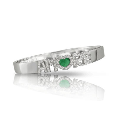 White gold bracelet with white diamonds and emerald