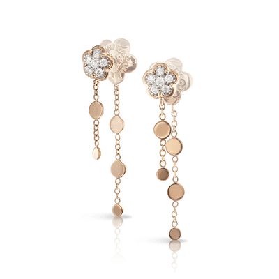 White and rose gold earrings and diamonds