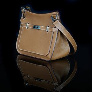 Hermes-Hand Bag-H 10.24 in. x W 5.91 in. x D 13.39 in.H 26 cm x W 15 cm x D 34 cm 13.39 in. (34 cm) Size: 34 Hardware: Silver Release Date: 2010 Colour: Brown Material: Grained Leather 100%, Silver Made in Italy-fabriqe.com