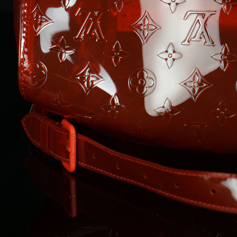Louis Vuitton-Keepall-19.69 x 11.42 x 9.06 inches ( length x height x width ) L 50 x H 22 x W 29 cm/L 19.7 x H 8.7 x W 11.4 inches Red Transparent embossed Monogram PVC PVC trim Silver-colour and tone-on-tone detailing Top handle for hand or elbow carry Leather handle fastener Double zip closure Leather-covered padlock ornament Resin chain Removable leather strap for shoulder or cross-body carry-fabriqe.com