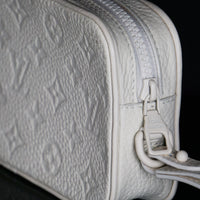 Louis Vuitton-Clutch-WT-9.06 x 4.53 x 1.57 inches ( length x height x width ) L 21.3 x H 12 x W 4.8 cm/ L 8.4 x H 4.7 x W 1.9 inches Powder White Taurillon Monogram Cowhide leather Textile lining Tone-on-tone hardware Matte-effect resin chain Removable strap Zip front pocket Zip inside compartment-fabriqe.com