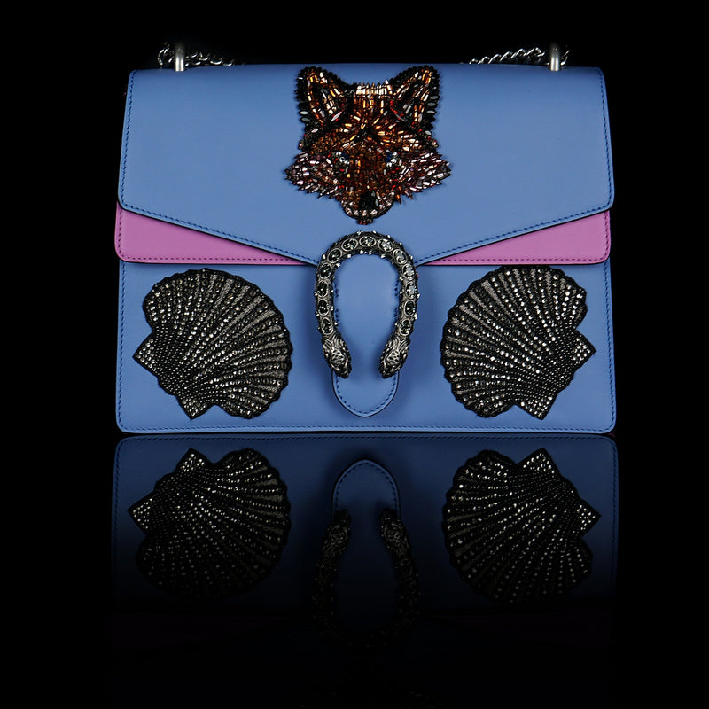 Gucci-Dionysus Shoulder Bag-Selfridges exclusive Blue Leather, a material with low environmental, Pink sides Antique silver-toned hardware Fox's head and Shells design made with sequins Tiger head closure Interior zippered compartment Pocket under the flap External rear pocket Sliding chain strap can be worn as a shoulder strap with 35 drop or can be worn as a top handle with 22 drop Medium size: W30cm x H21cm x D10cm Suede lining with interior pockets Made in Italy The model is 178 cm-fabriqe.com