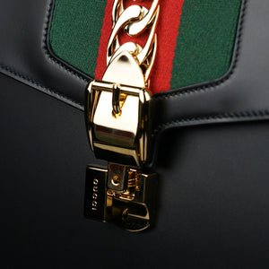 Gucci-Sylvie Bag-Black leather Gucci Flag Gold toned hardware Interior zip and smartphone pockets Handle with 12cm drop Detachable shoulder strap with 41cm drop Nylon Web detail with metal chain and buckle closure Made in Italy-fabriqe.com
