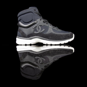 Chanel-CC Sneakers-Pre Order Duration (3-5 Working Days) CC Logo on side Black Black White Rubber Sole 2017 Release Limited Stock Chanel CCs crafted in mixed fabric sports CC branding on the side. Nylon at vamp, leather touch at white and suede line finish grabs the spotlight! In the 2017 limited release the sneakers carry Chanel typography on the rubber sole. Pre-order Exclusive!-fabriqe.com