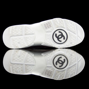 Chanel-CC Sneakers-Pre Order Duration (3-5 Working Days) CC Logo on side Maroon, Grey, Bronze Rubber Sole 2018 Release Limited Stock Chanel CCs crafted in mixed fabric sports CC branding on the side. Embellished in Maroon and Grey with a bronze touch. Nylon at vamp, leather touch at back and suede line finish grabs the spotlight! The sneakers carry Chanel typography on the rubber sole.-fabriqe.com