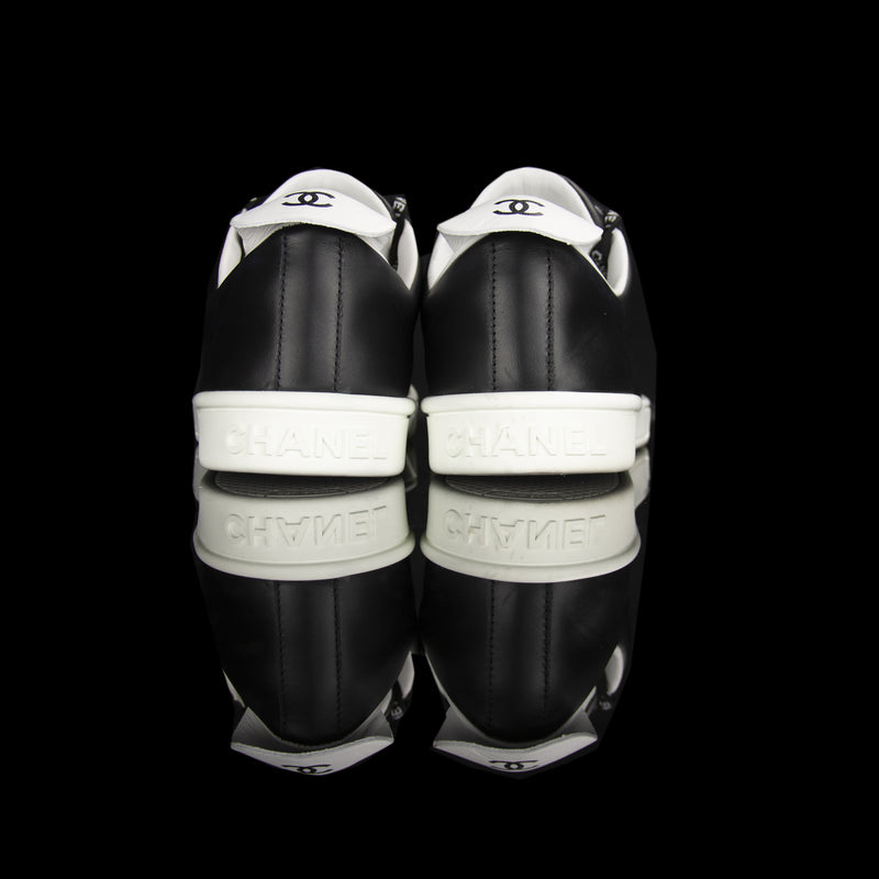 Chanel-Weekend sneakers-Colour: Black, White Mid Sole, White outer sole Limited Edition Calfskin Leather Chanel text on laces White Pull tab Black CC Logo on pull tab-fabriqe.com