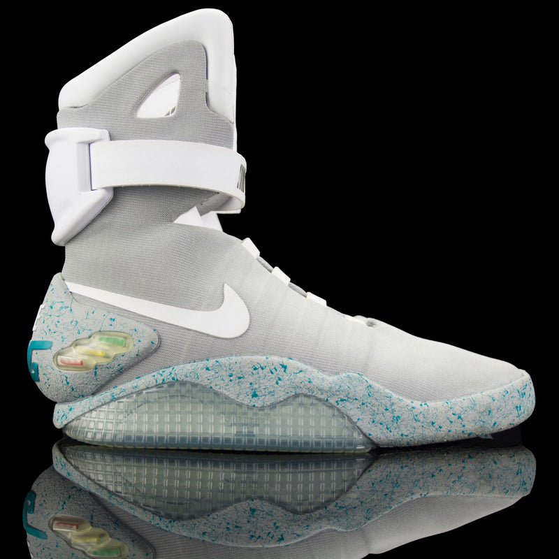 "Nike-Air Mag-Pre Order Duration (3-5 Working Days) Product Code: 417744-001 Exclusive Release LED Lighting Release Date: October 2011 The Future is here. Nike Air Mags featured in the movie ""Back to the Future II"" are an iconic design by Tinker Hatfield. These extremely exclusive sneakers needs no mention. 2011 Release.-fabriqe.com"