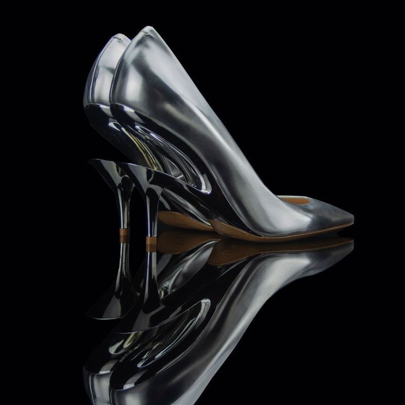 Maison Margiela-Heels-Silver/Chrome Pointed toe Stiletto heel 2108 Release Material: 70% Polyester/30% Cotton Second fabric: 100% Polyurethane Maison Margiela known for its exclusive cut out heels collection brings you fresh release this season. Embellished cut out heel in black and composed in silver body with pointed toe. Maison is the perfect confluence of class and exclusivity.-fabriqe.com