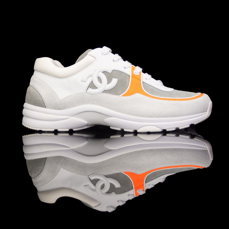 Chanel-CC Sneakers-Pre Order Duration (3-5 Working Days) CC Logo on side Cream, White,Grey, Orange Suede, Rubber Sole 2018 Release Limited Stock Chanel CCs crafted in leather and suede fabric sports CC branding on the side. Composed on rubber sole that carries Chanel typography. Also, the color of white, grey and orange is sure to grab the spotlight! In addition, the 2018 limited release is now Pre-order Exclusive!-fabriqe.com