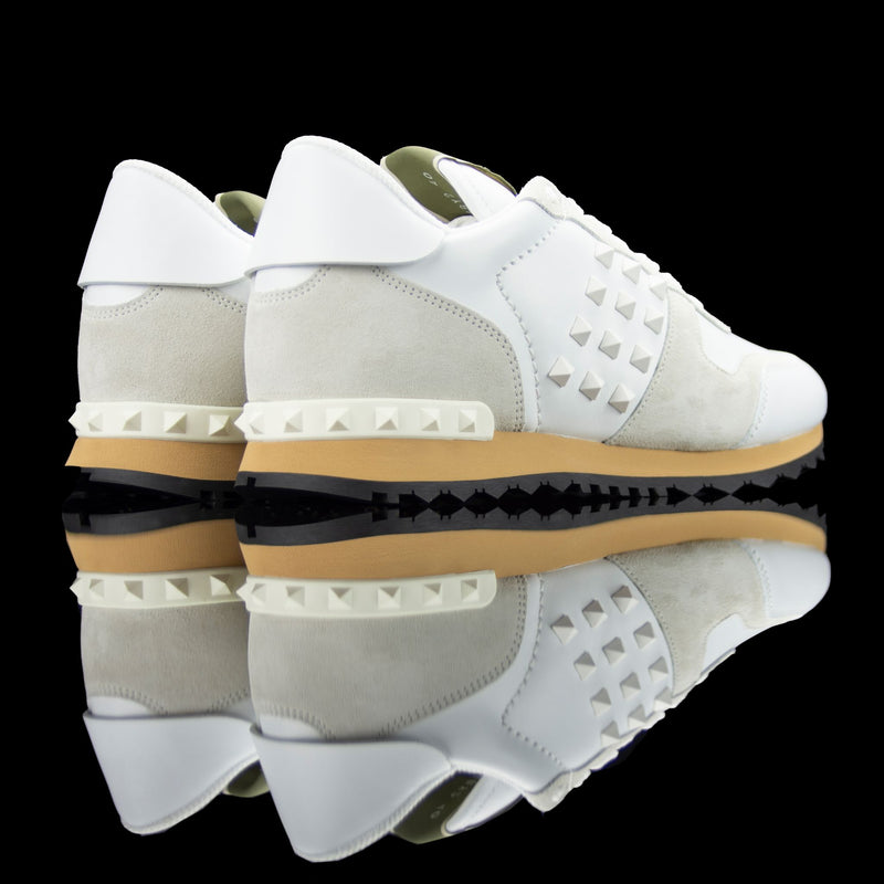 Valentino-Rockstud Sneakers-Product Code: PY2S0748 Colour: Cream/White Material: Leather, Suede, Rubber Sole Valentino Rockstud collection brings you studded sneakers in cream and white. Crafted in leather and suede fabric and based on rubber sole. In addition, the studded belt on the vamp and heel in white is surely the gateway to catch eyeballs.-fabriqe.com
