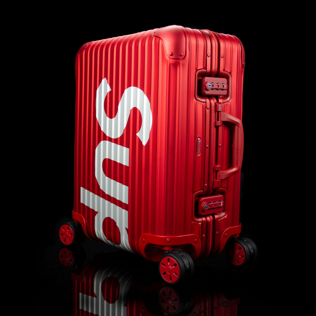Rimowa-Suitcase-Colour: Red Exclusive-Limited Stock Aluminium/Aluminum, Plastic Handle Supreme X Rimowa Topas brings you the multiwheel suitcase. Designed exclusively for Supreme in aluminium bodies by Rimowa. This suitcase feature TSA combination locks and rolling multiwheels. Made in red colour of 45L carry on size. So, where you rolling it to this Spring?-fabriqe.com