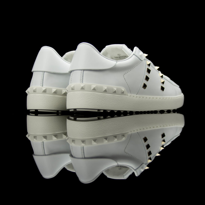 Valentino-Rockstud Sneakers-White leather Silver Rockstuds, leather linings, rubber soles Lace-up Come with dust bags Made in Italy Rockstud Untitled low by Valentino is a piece of intricate design. A luxury statement crafted in white leather and studded in silver. Featuring white studded strip at back and set on a rubber sole. Need we say more?-fabriqe.com