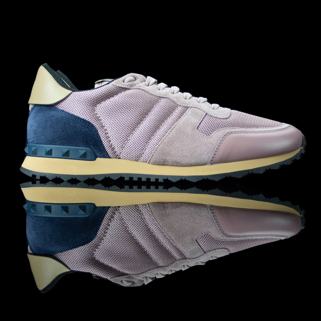 Valentino-Rockstud Sneakers-Product Code: Colour: Pink / Navy Material: Leather, Suede, Canvas, Rubber Sole Valentino Rockstud collection brings you canvas sneakers in pink and navy. Crafted in leather, suede and canvas fabric and is based on rubber sole. In addition, the studded navy belt on the back makes it a perfect casual wear!-fabriqe.com
