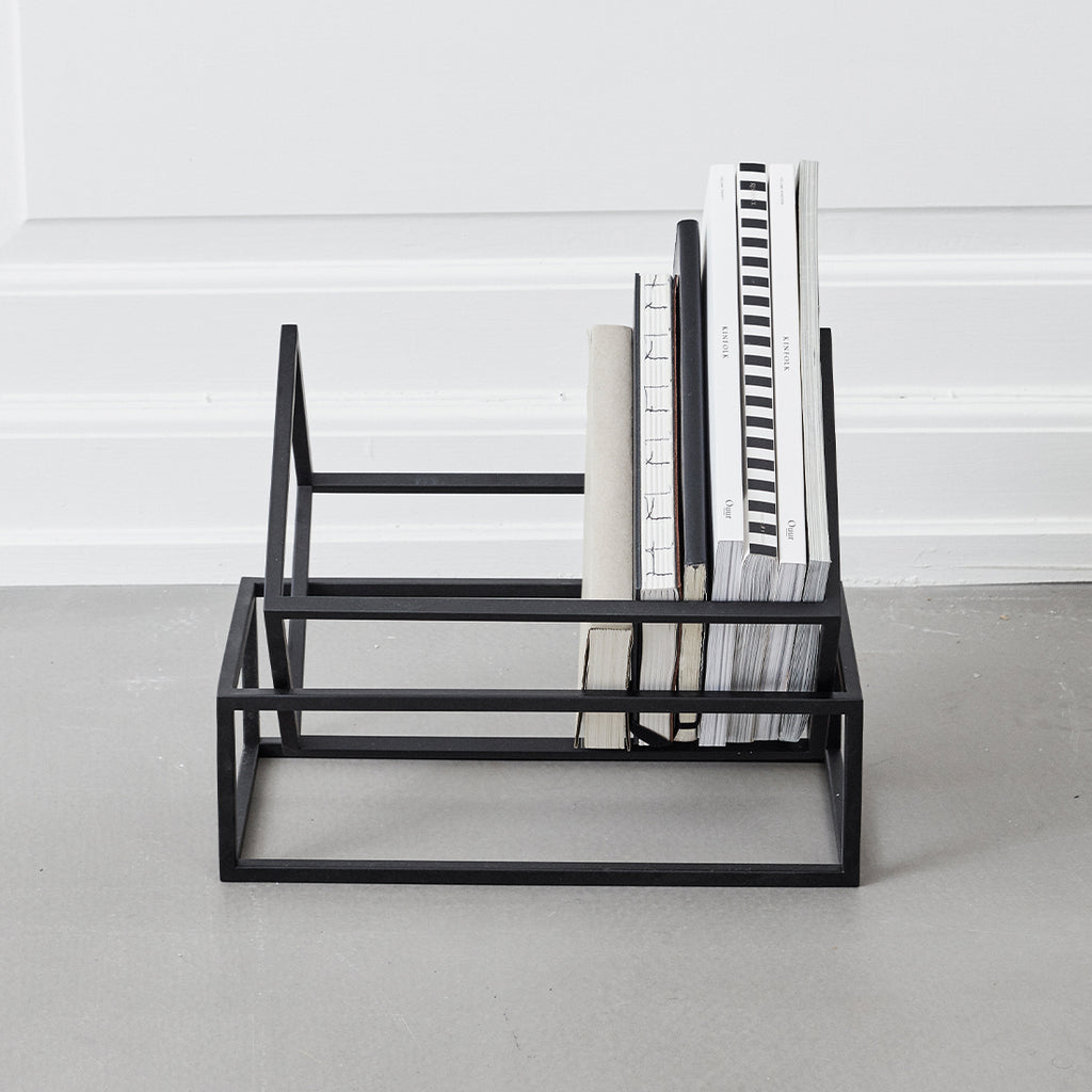 Elegant, simple and sculptural book storage from Kristina Dam