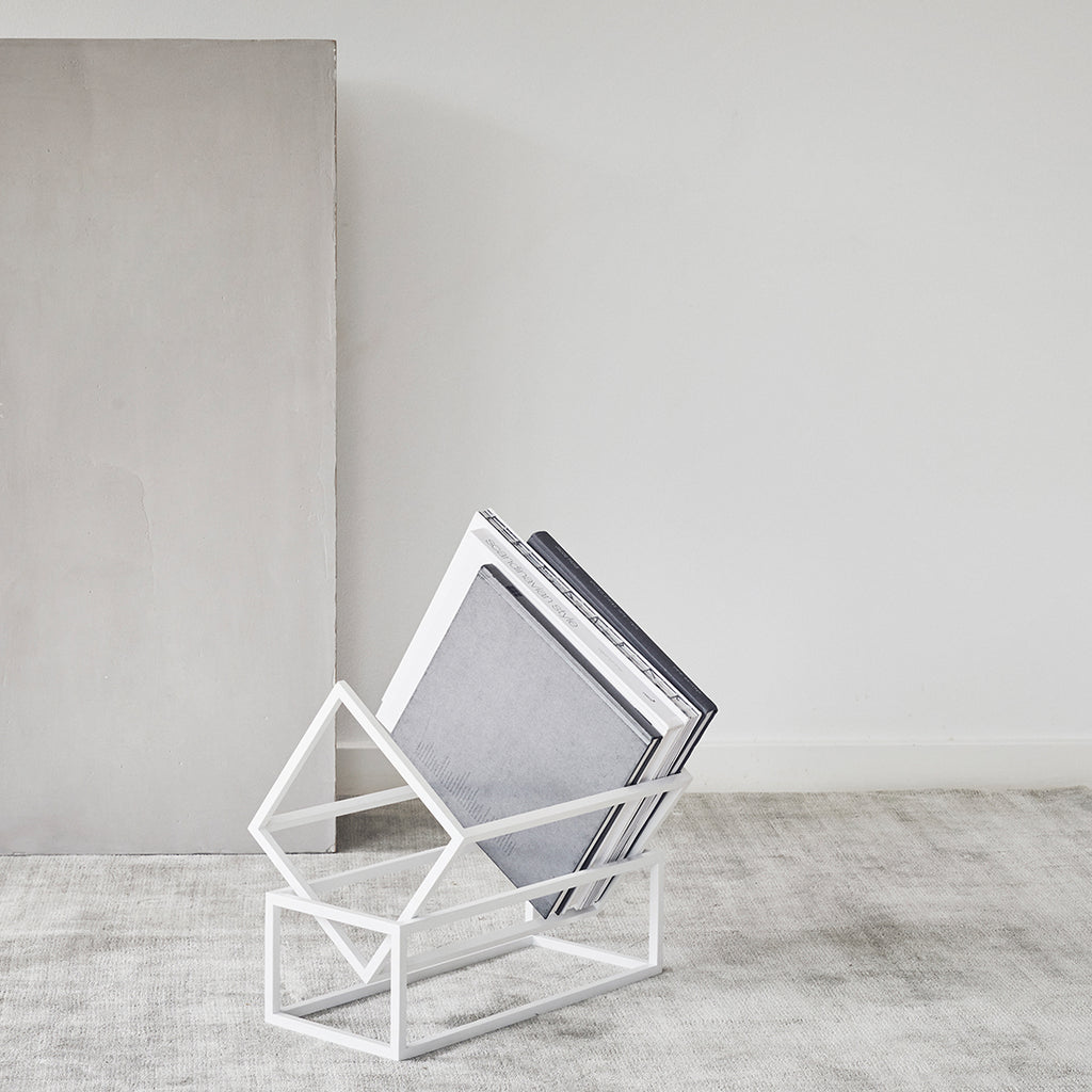 Simple and sculptural book storage designed by Kristina Dam