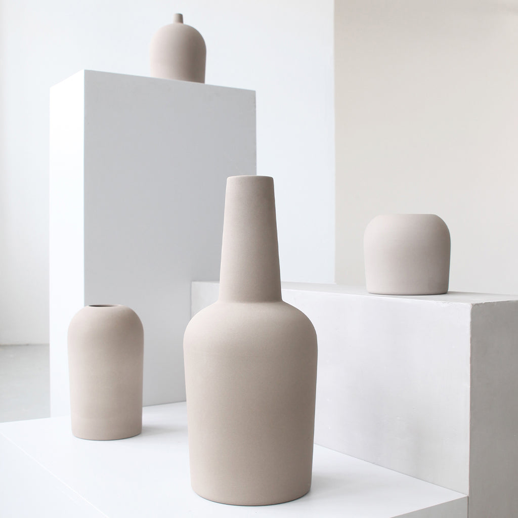 Dome vase collection with neutral gray terracotta vases