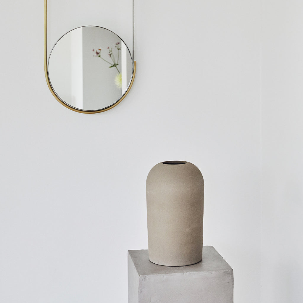 Kristina Dam's grey terracotta vase and Mobile mirror design from Denmark