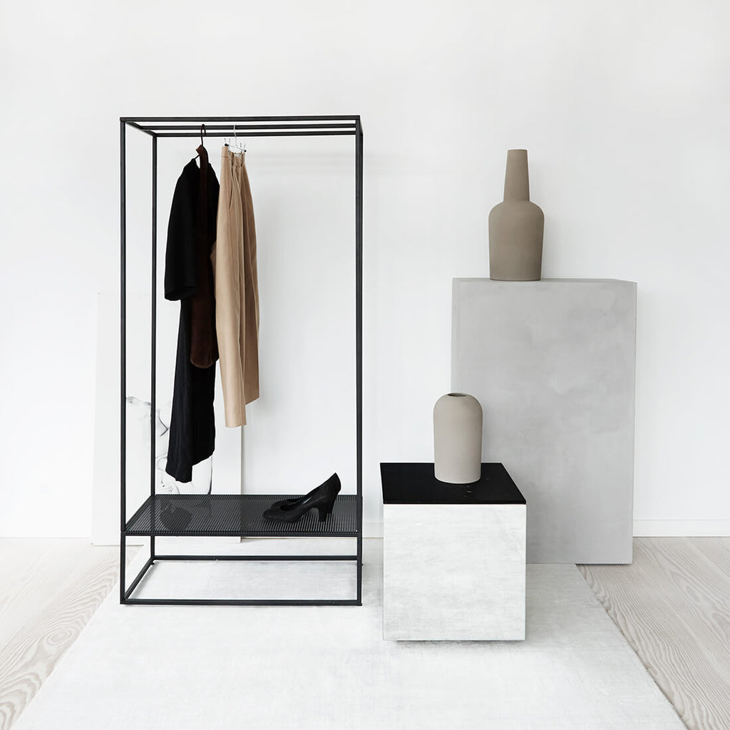 minimalistic black steel clothes rack kristina dam studio