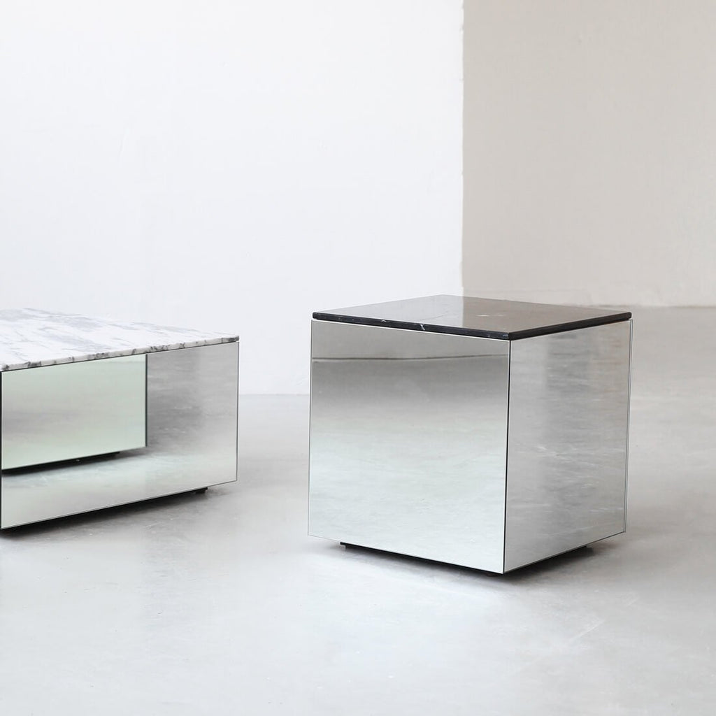 kristina dam studio collection of marble and mirror coffee tables