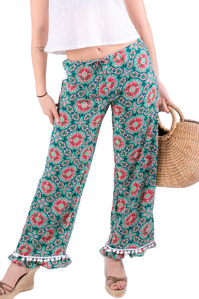 Summer colourful printed pants with a ruffle and pompom trim at the bottom