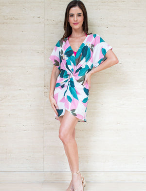 Knotted beach caftan in tropical pink flowers. Slip on, relaxed style. Acqua Bonita Resort wear fashion.