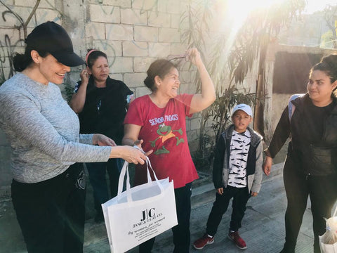 A poor family in Tijuana, Mexico receives a bag of food, water and other donated necessities