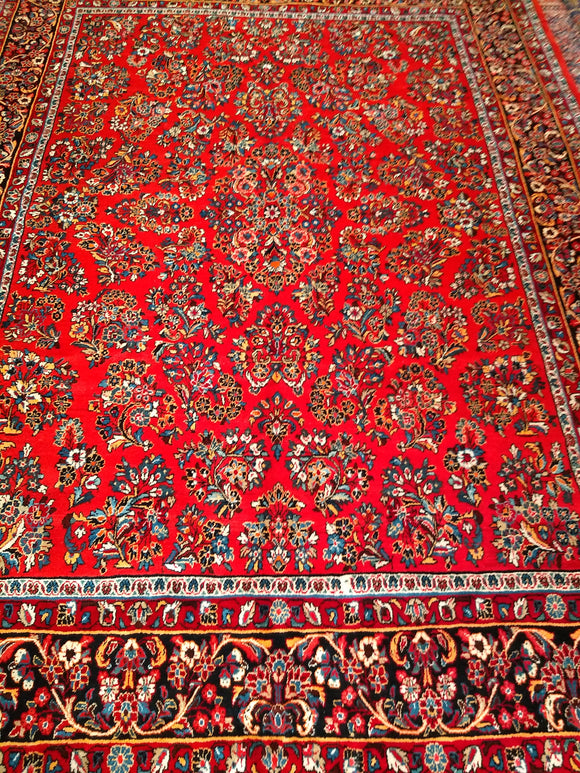 A Vintage Room Size Persian Sarouk Rug
