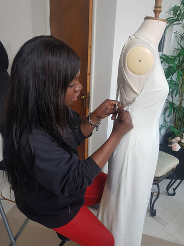 In her zone, Paulinah working on a bespoke creation at her studio