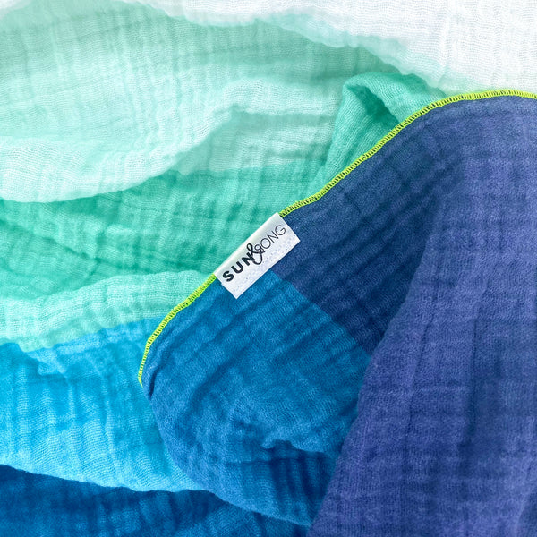 aqua and navy blue gradient waves organic blanket