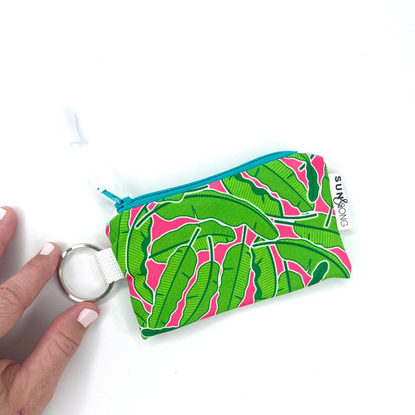 banana leaves and pink small zipper pouch
