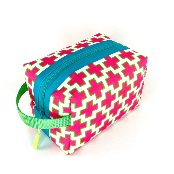 pink swiss cross waterproof boxy travel pack