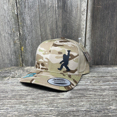 SASQUATCH BLACK LEATHER SHAKA PATCH - FLEXFIT-SNAPBACK Leather Patch Hats Hells Canyon Designs Arid/Tan Multicam
