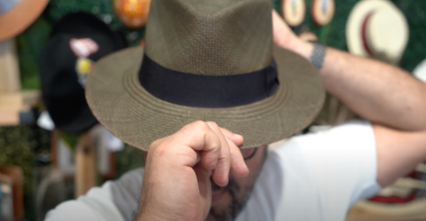 Holding a Panama Hat