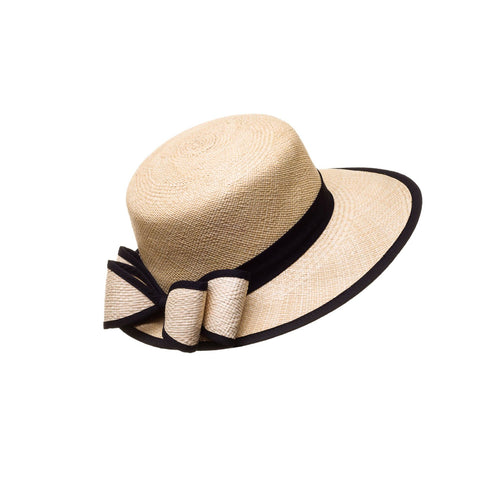 """La Visera"" is a classic elegant hat for all women. Handmade out of natural Toquilla Palm Tree. A exclusive design from El Galpón this beautiful hat comes in tree colors to choose. We ship to all US states and PR.  Handmade hats made in Ecuador dreamed in Puerto Rico. Shop online!"