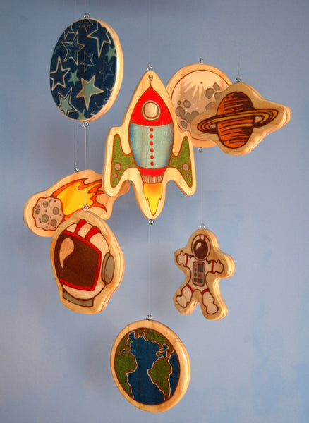 outer space baby mobile for a baby boy's nursery