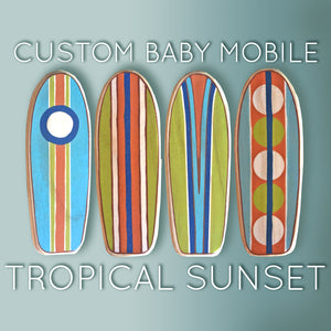 baby crib mobile with surfboards in a tropical range of vibrant colors