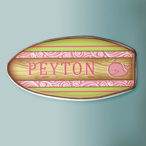 A pink and green surfboard to decorate a beach themed room.