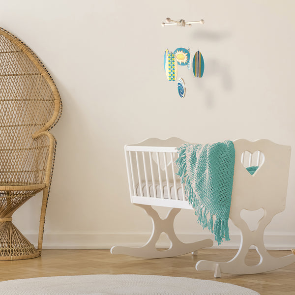 perfect crib mobile for a boho beach baby nursery
