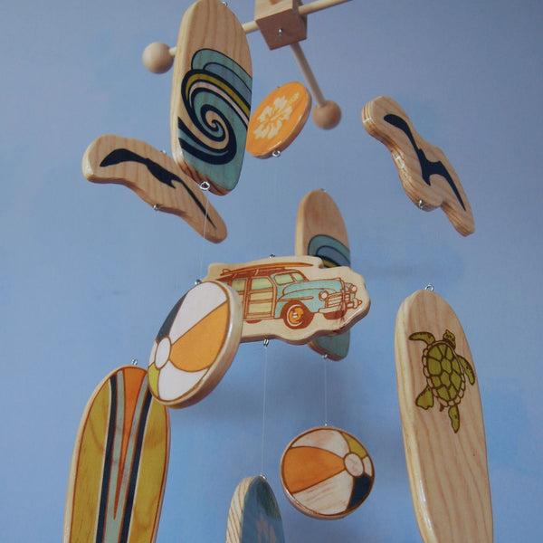 wooden surfboard baby mobile for a beach themed baby room