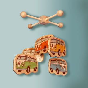 colorful vintage volkswagen buses adorn this handmade wooden baby mobile