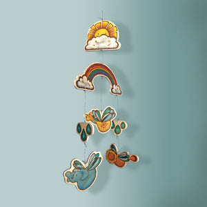 Whimsical Baby Mobile with rainbow, sun, and flying animals