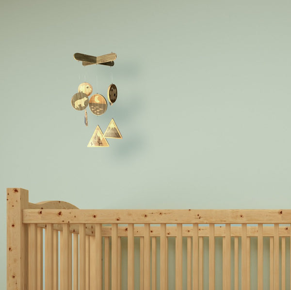wooden baby mobile hanging from ceiling