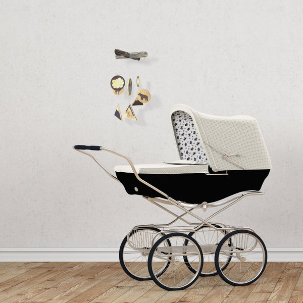 gender neutral baby room crib mobile with woodland theme